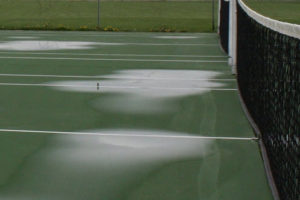 puddles on tennis court